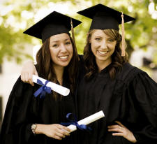 Two women graduating with diplomas in hands